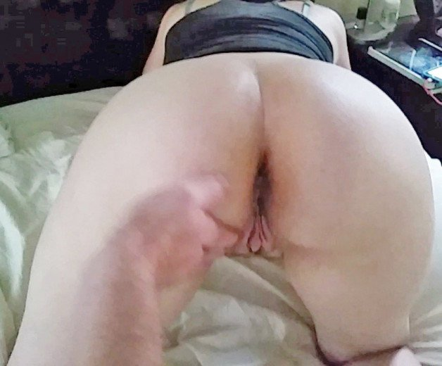 Photo of hubby rubbing my plump ass and pussy before eating...