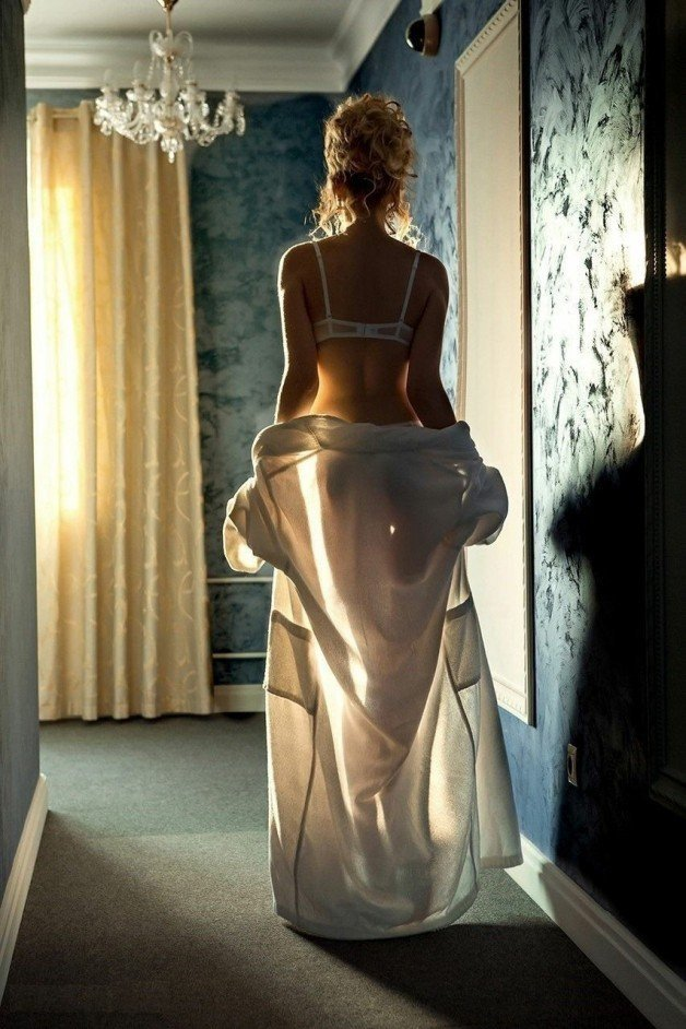 She continued walking toward the bedroom, shedding more...