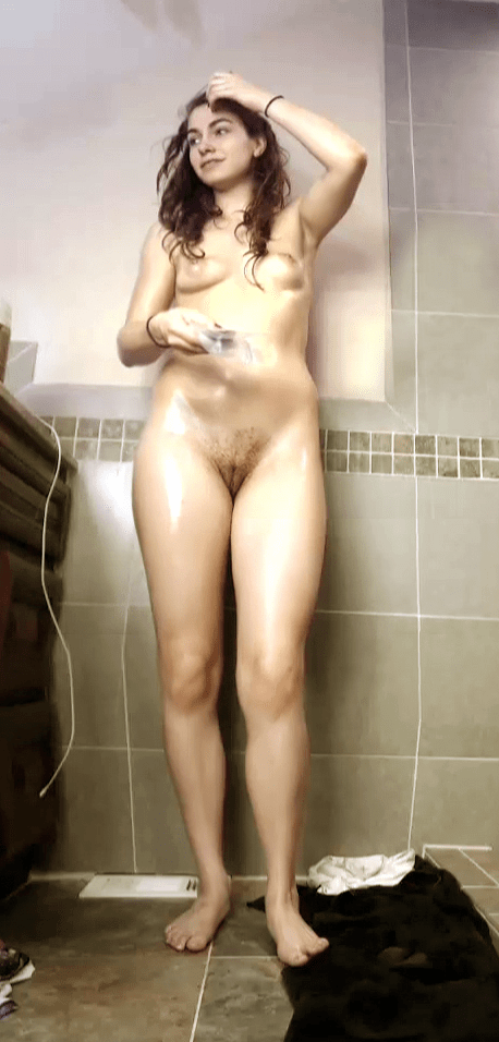 A candid shot of Marley standing naked in the shows after a...
